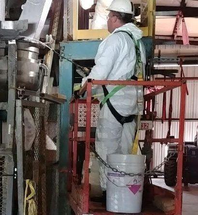 Technicians on manlift