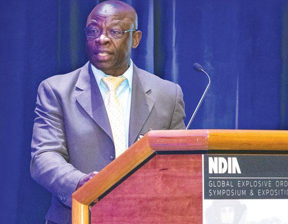 Dr. Nzengung speaking at a symposium